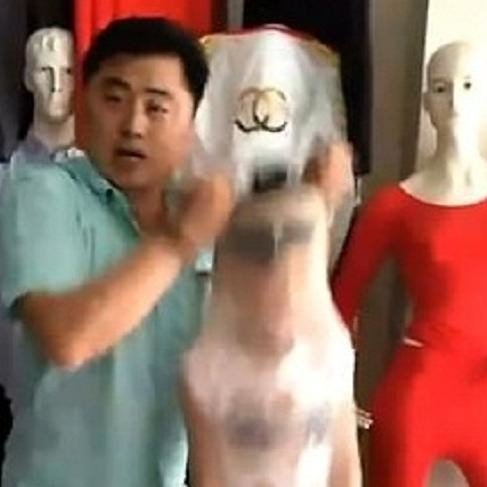 Chinese man gives hillarious demonstration of pantyhose tights by stuffing his son in it