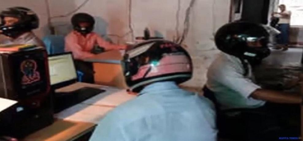 Employee at land records department in East   Champaran district of Bihar working wearing   helmet