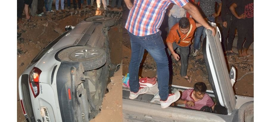 pics of a car falls down in a pit in lucknow