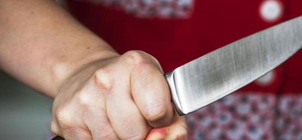 husband attack on his wife with axe and knife