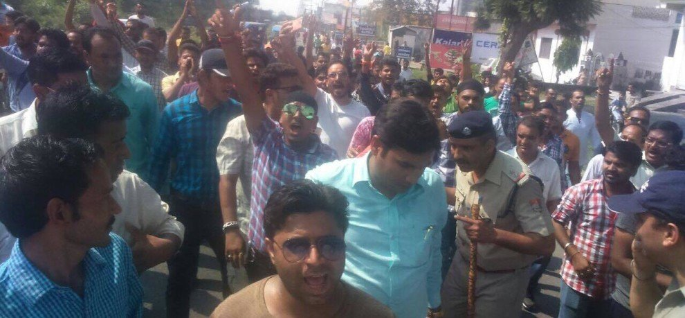 protest after youth murder in raiwala