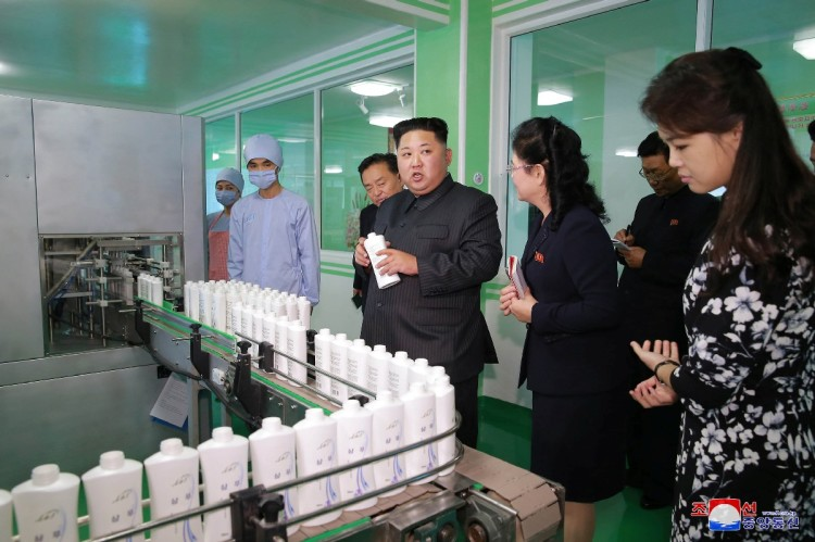 Kim Jong Un appearance with wife at makeup factory in North Korea