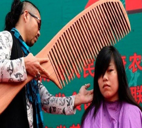 worlds largest comb and scissors used on this girl for hair cut
