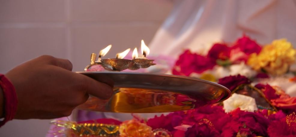 use of flowers in the worship also leaves are considered to be auspicious