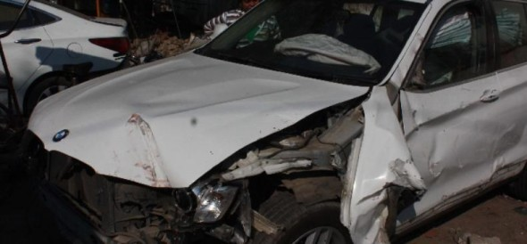 businessman was drunk and driving bmw and hit the divider, injured