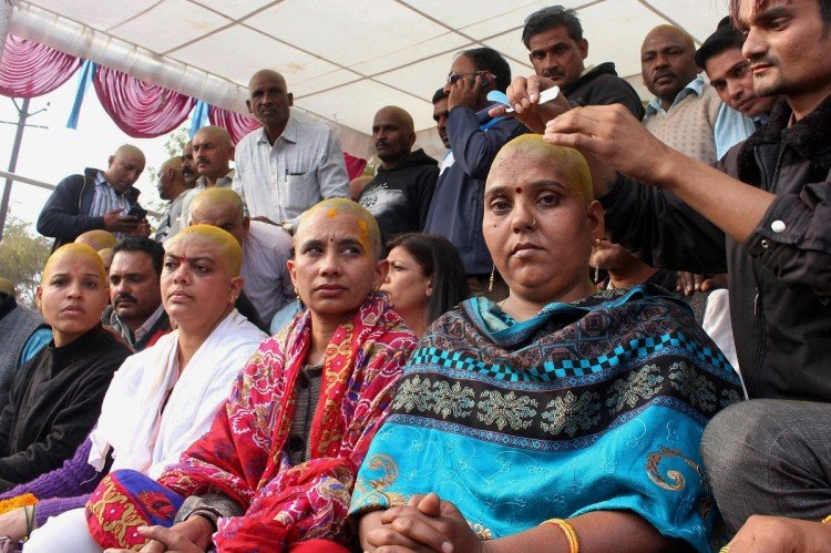 Teachers shaved their heads demanding equal pay for equal work in Bhopal