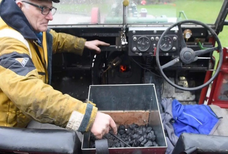 A Man converted land rover in steam engine car