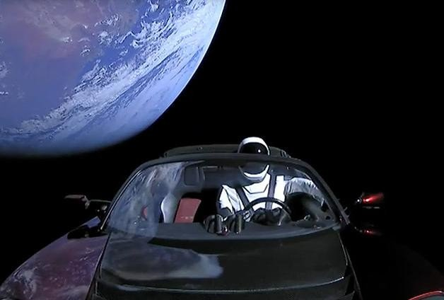 Amazing photos of space x  falcon heavy, sports car in Space