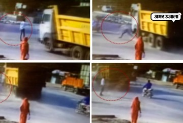 man makes a narrow escape after being hited by a dumper in gujarat