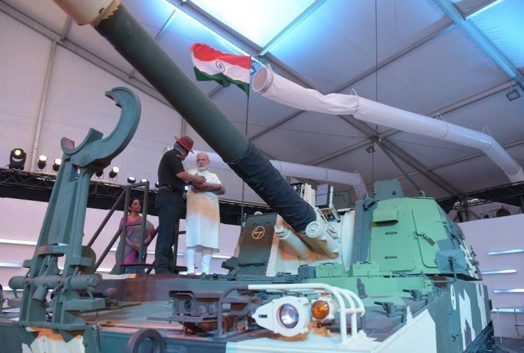 PM narendra modi seen arms of Indian and foreign companies in Defense Expo