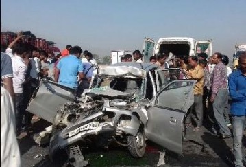 Two killed in car - tractor collision
