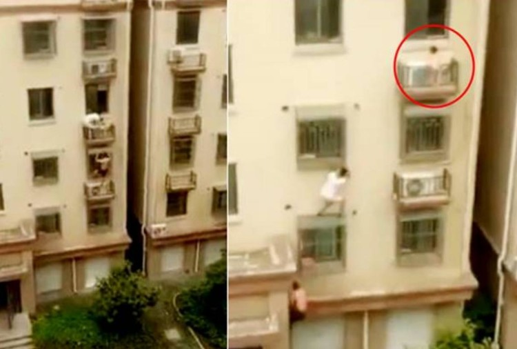 3 year old girl trapped on fourth floor window rescued by two people in China