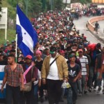 refugees cross into Mexico from river