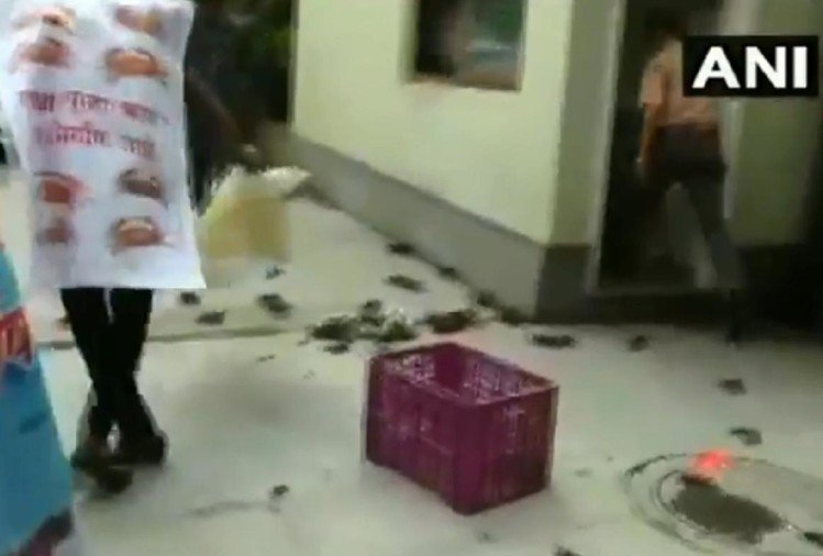 NCP workers stage protest and threw crabs outside the residence of Tanaji Sawant