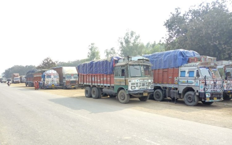 trucks standing on the road are the cause of accident