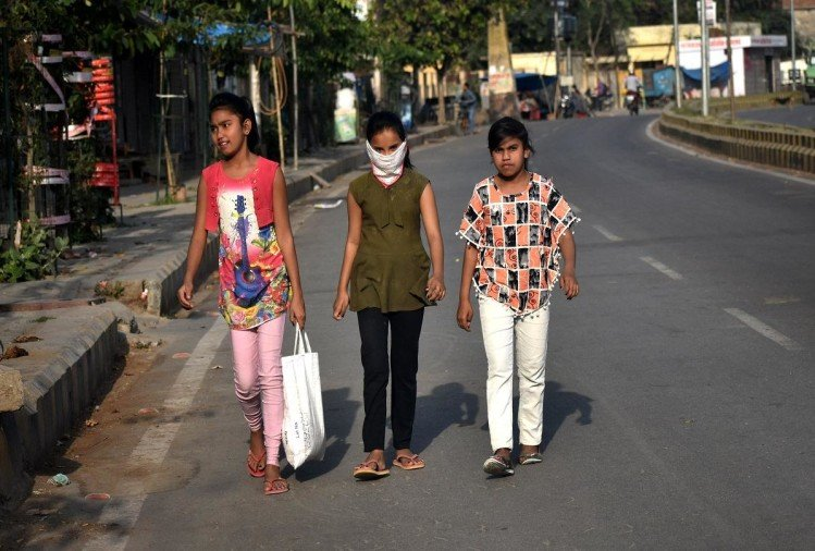 Children returning after taking the same in Alipibagh area during the lockdown.
