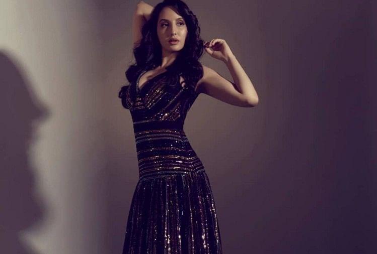 नोरा ब्लैक शिमरी ड्रेस में बेहद खूबसूरत नजर आ रही हैं
