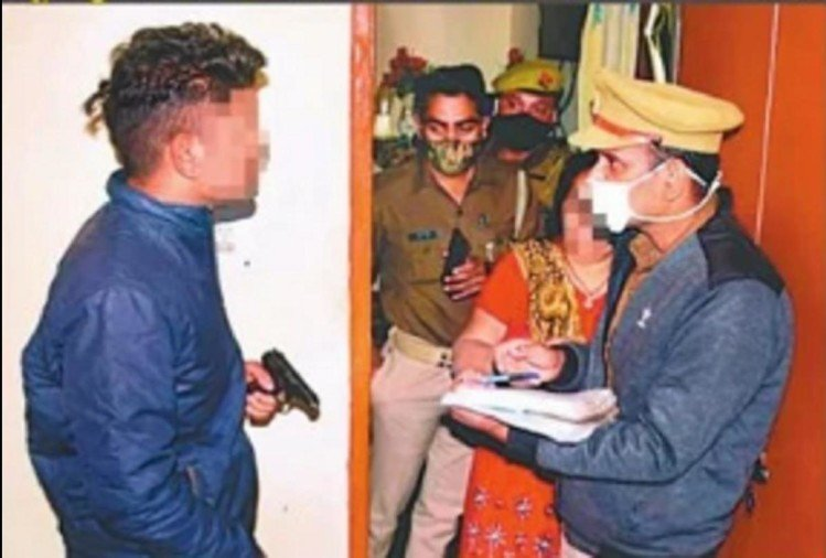 Accused youth handing pistol to police