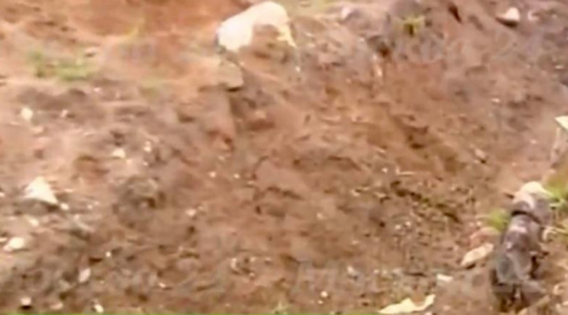 man BURIED ALIVE by Moscow gangsters uses his mobile to call for help from grave
