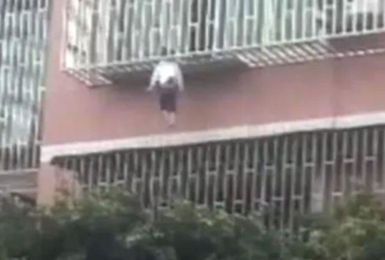 girl slips from balcony neck trapped in railing and body hung in air china shocking video viral