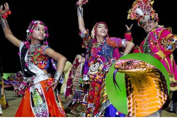 young girls performing garba holding cobras in hands