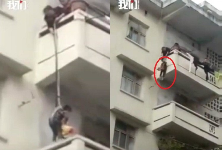 chinese woman dangle her grandson to save cat