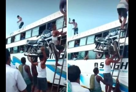 viral video of man who walk on ladder with bike on head people called him modern bahubali