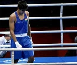 vijender had lost his match due to back pain