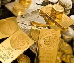 Gold almost flat in listless trade silver gains