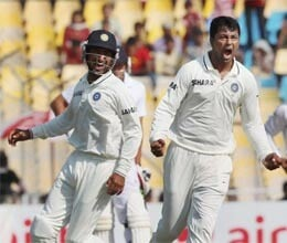 Ojha and Pujara hero of nine wicket win