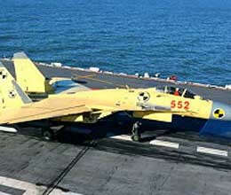 china conducts first landing on aircraft carrier