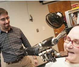 paralyzed woman moves prosthetic arm with her brain