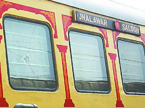 stones thrown on the luxury train palace on wheel